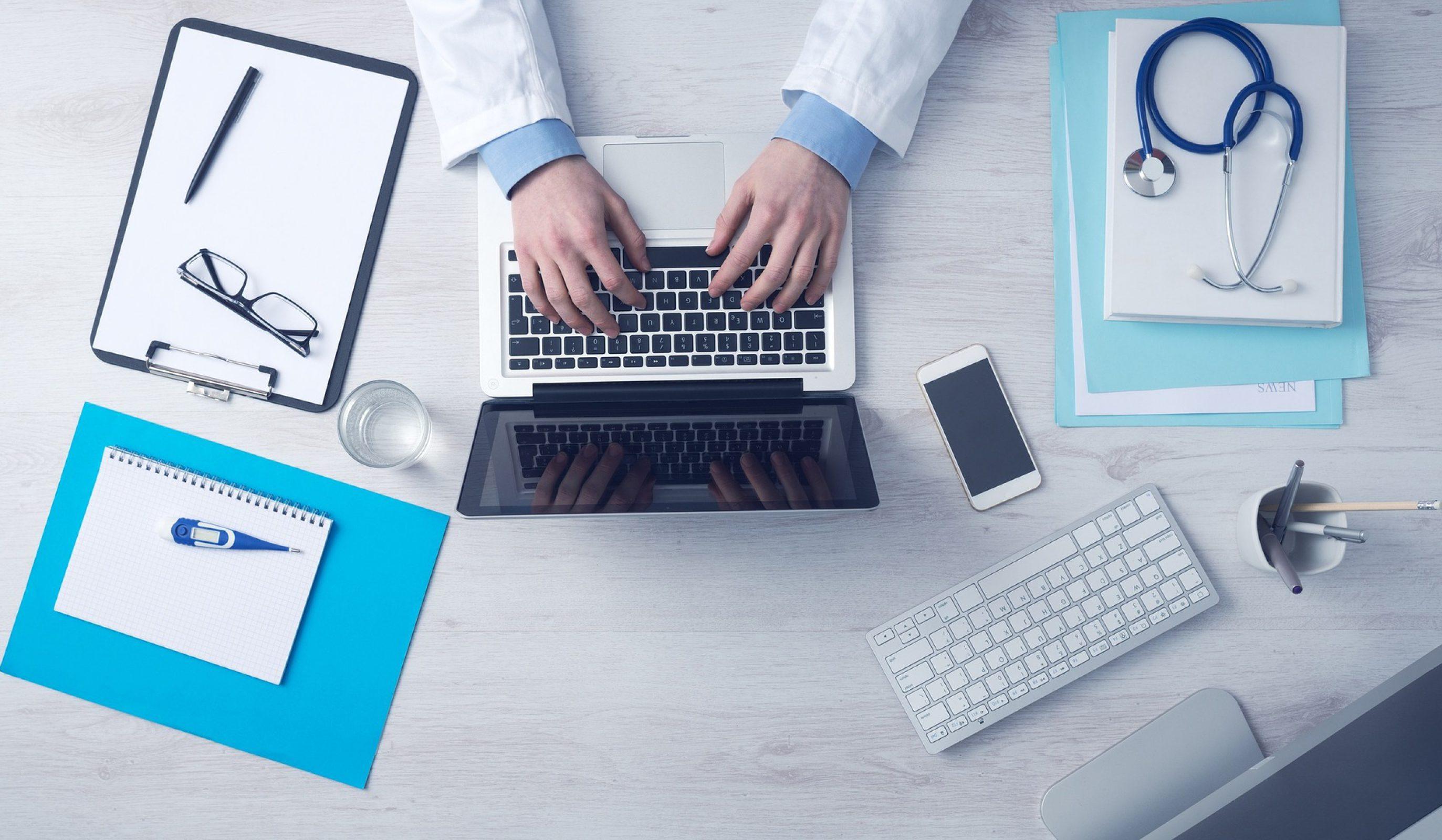 Doctor hands on computer